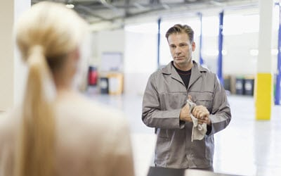 Car Mechanic & Owner Maintaining Social Distancing